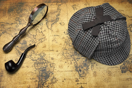 Deerstalker Hat Magnifier And Smoking Pipe On Map Stock Photo - Download Image Now