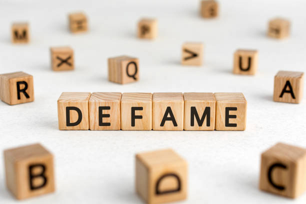 defame - words from wooden blocks with letters - defame stock pictures, royalty-free photos & images