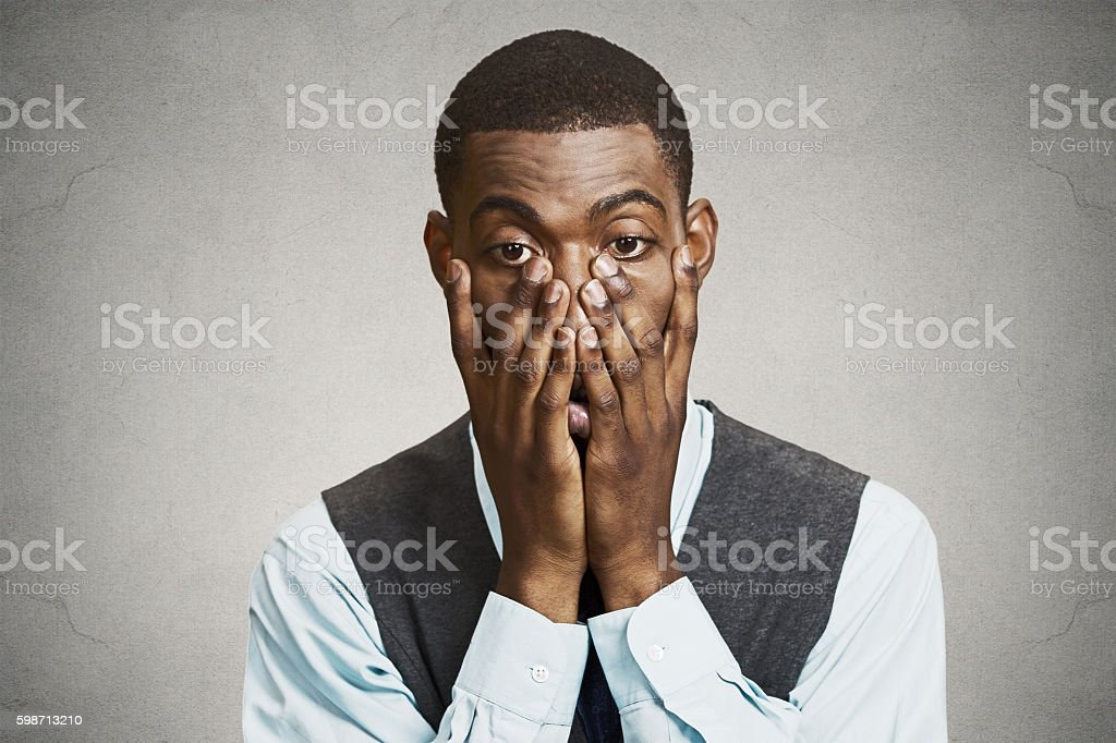 Defeated, stressed young businessman stock photo