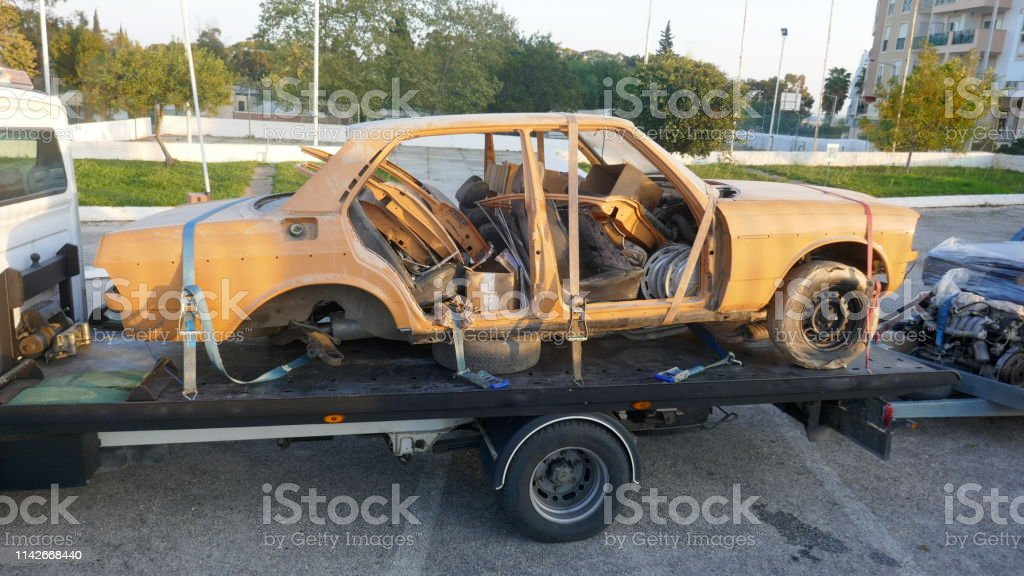 Defective Car On A Tow Truck Stock Photo - Download Image Now - iStock