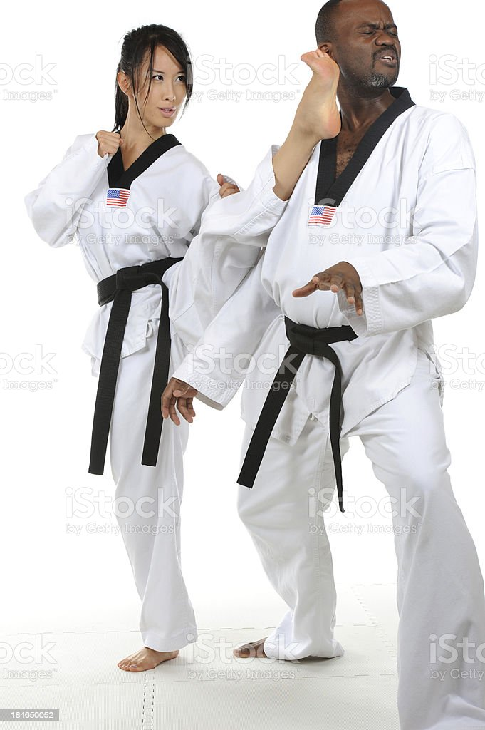 Defending with a front kick stock photo