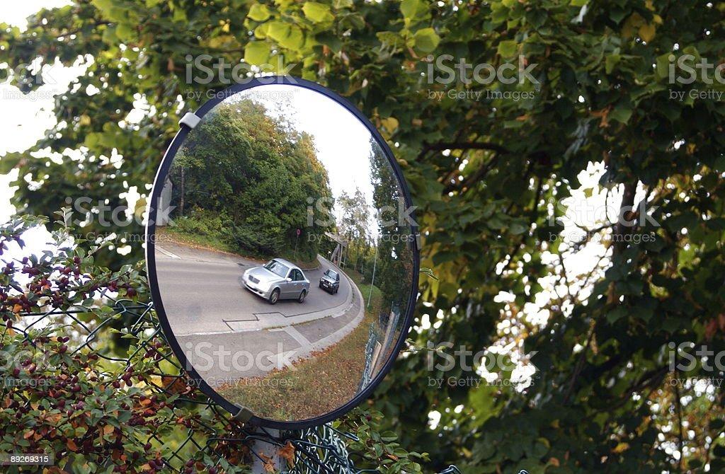 Defensive Driving Mirror on Hidden Corner in Europe royalty-free stock photo