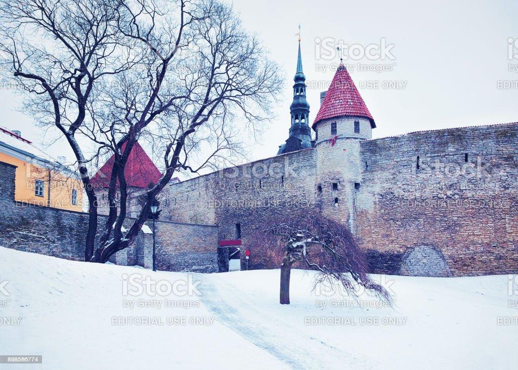 Defensive walls and Spire of St Nicholas Church at Tallinn stock photo