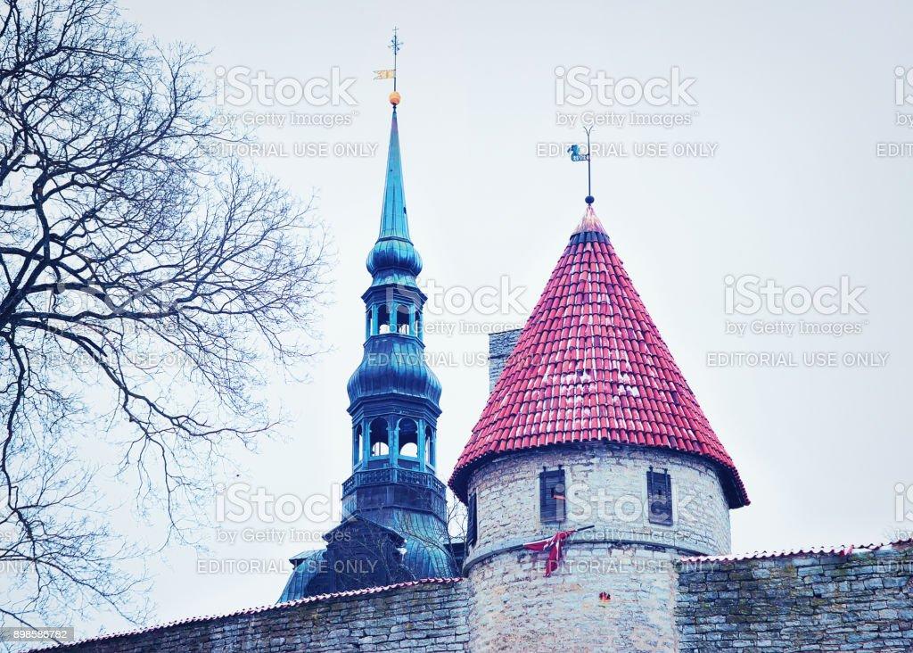 Defensive walls and Spire of St Nicholas Church in Tallinn stock photo