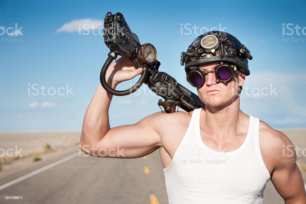 Defiant Apocalyptic Survivor with Gun royalty-free stock photo
