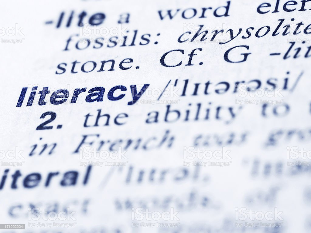Definition for literacy in the dictionary page stock photo