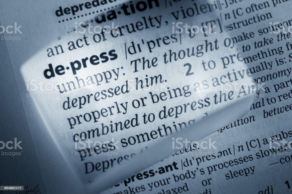 Definition of Depress stock photo
