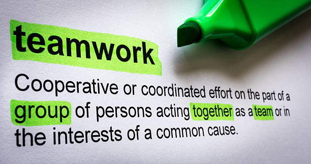 Definition of teamwork, highlighted in colour. – Foto