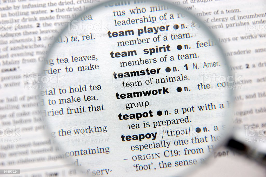 Definition of teamwork royalty-free stock photo