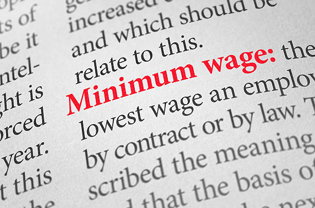 Definition of the word Minimum wage in a dictionary stock photo