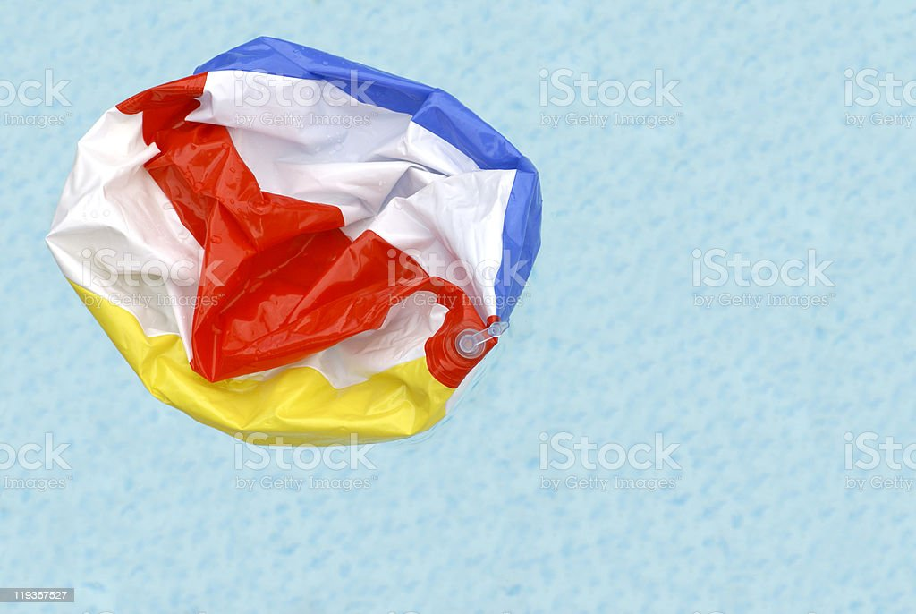 Deflated Beach Ball in Pool royalty-free stock photo