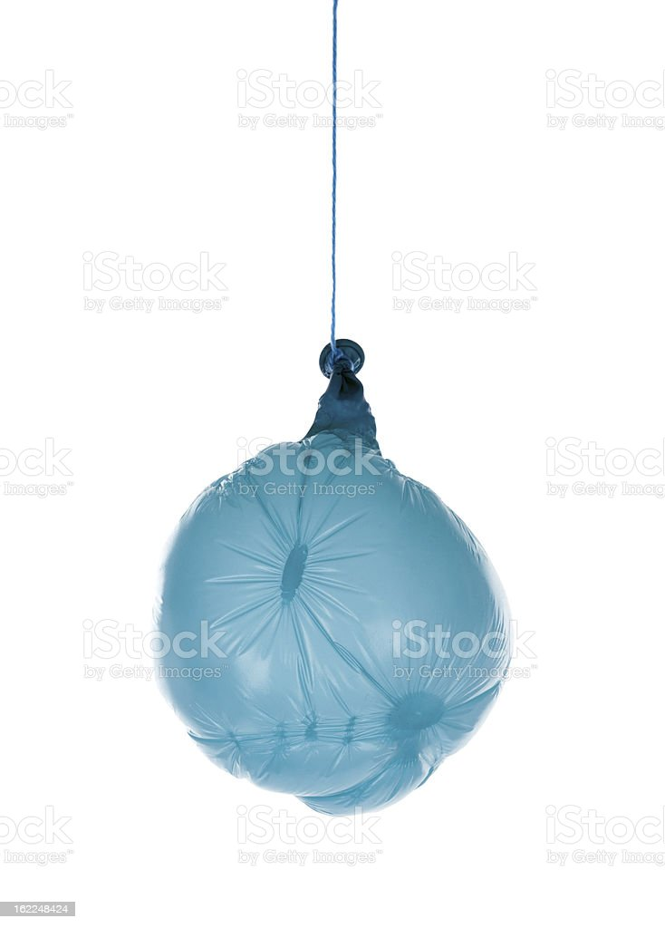 Deflated blue balloon at a rope; isolated over white stock photo