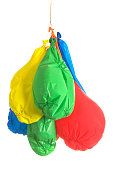 Coloured baloons which have deflated.