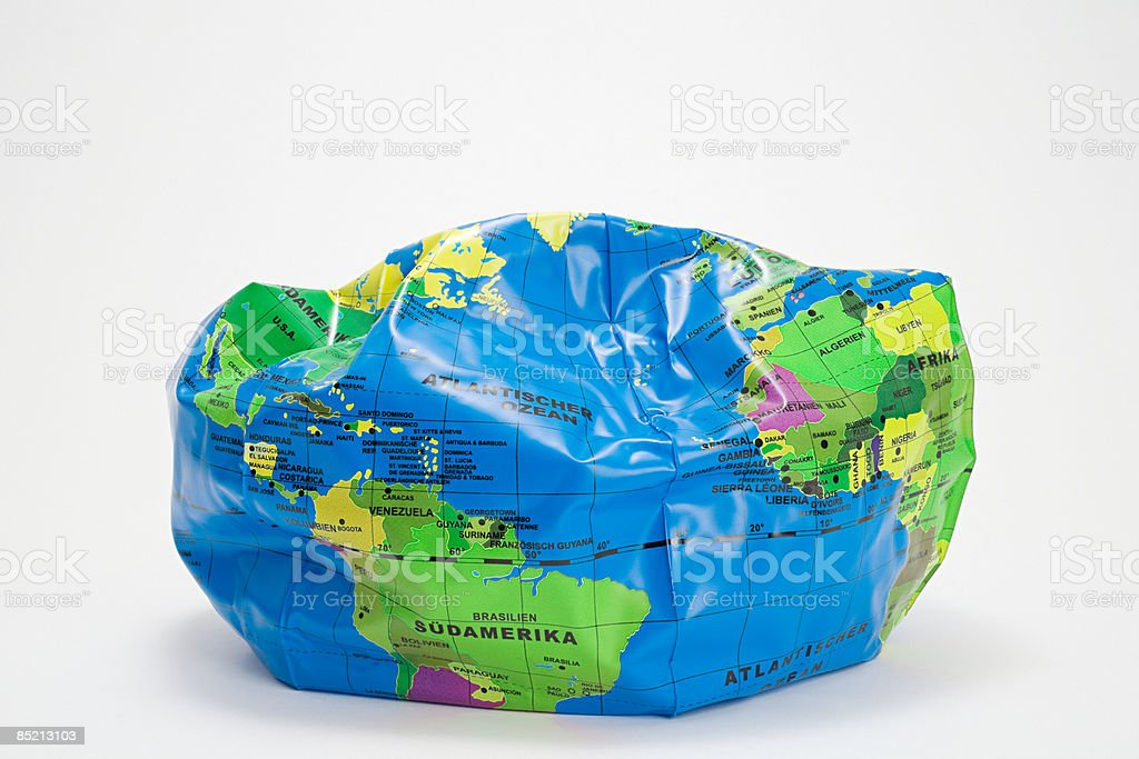A deflated globe beach ball royalty-free stock photo