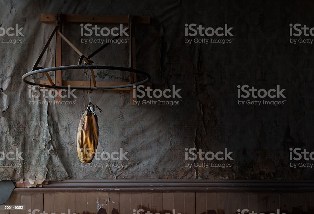 Deflated Old Punching Bag stock photo