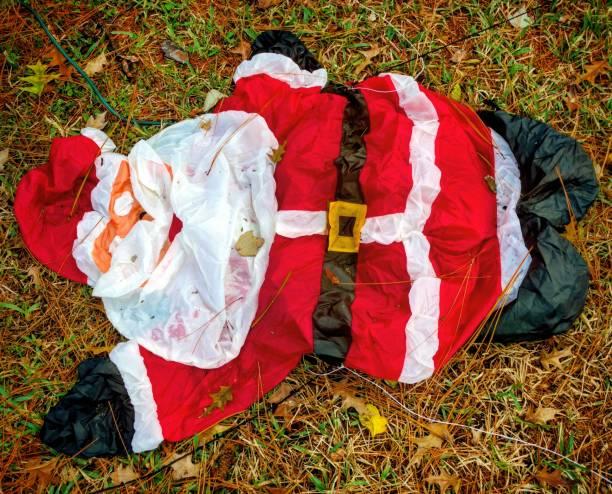 Deflated Santa on the Lawn stock photo