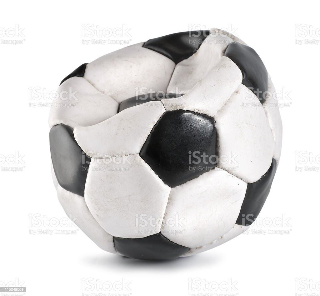 Deflated soccer ball isolated stock photo
