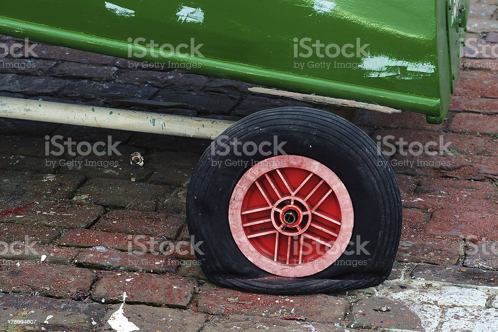 deflated tire with wheel flat royalty-free stock photo