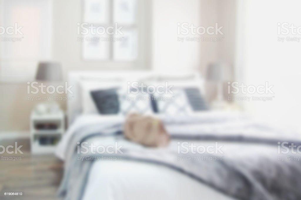 defocus blur abstract background of modern bedroom interior stock photo