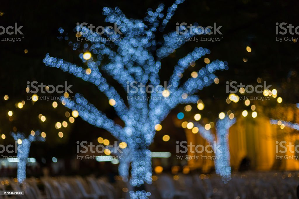 Defocus light from a light bulb decked in Christmas. royalty-free stock photo