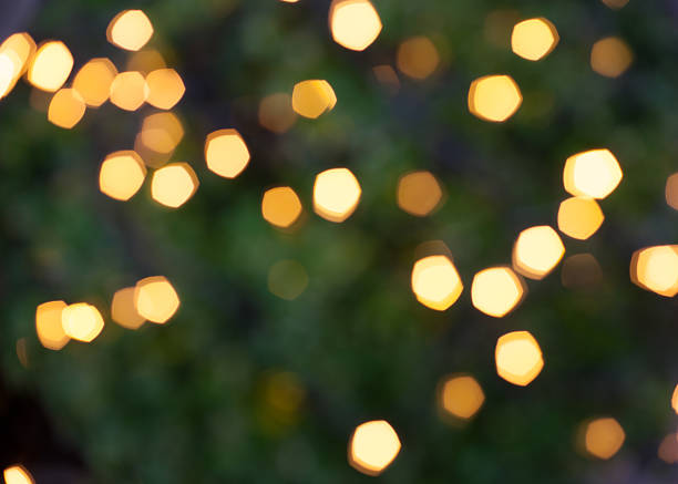 defocus light from christmas tree abstract green yellow background stock photo