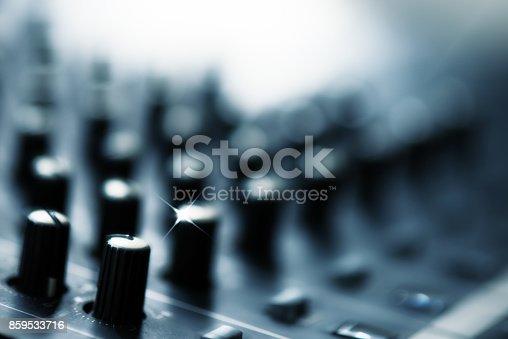 istock Defocus of digital audio mixer knops shallow dept of field for background 859533716