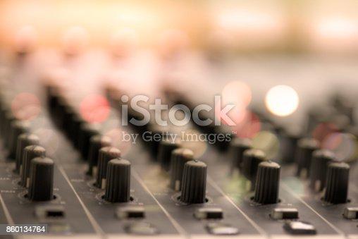 istock Defocus of digital audio mixer knops shallow dept of field for background 860134764