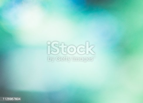876018792 istock photo Defocused Abstract Background Blue Green.Blue glowing holiday blurred background. 1125957604