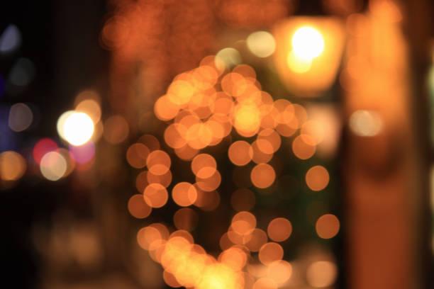 defocused abstract city street lights at night stock photo