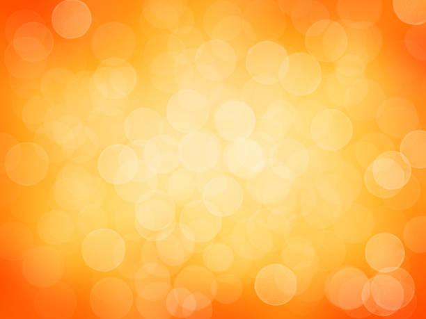 Defocused abstract lights on orange background. stock photo