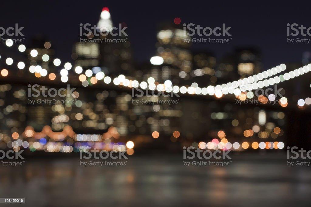 defocused abstract manhattan skyline - brooklyn bridge in front stock photo