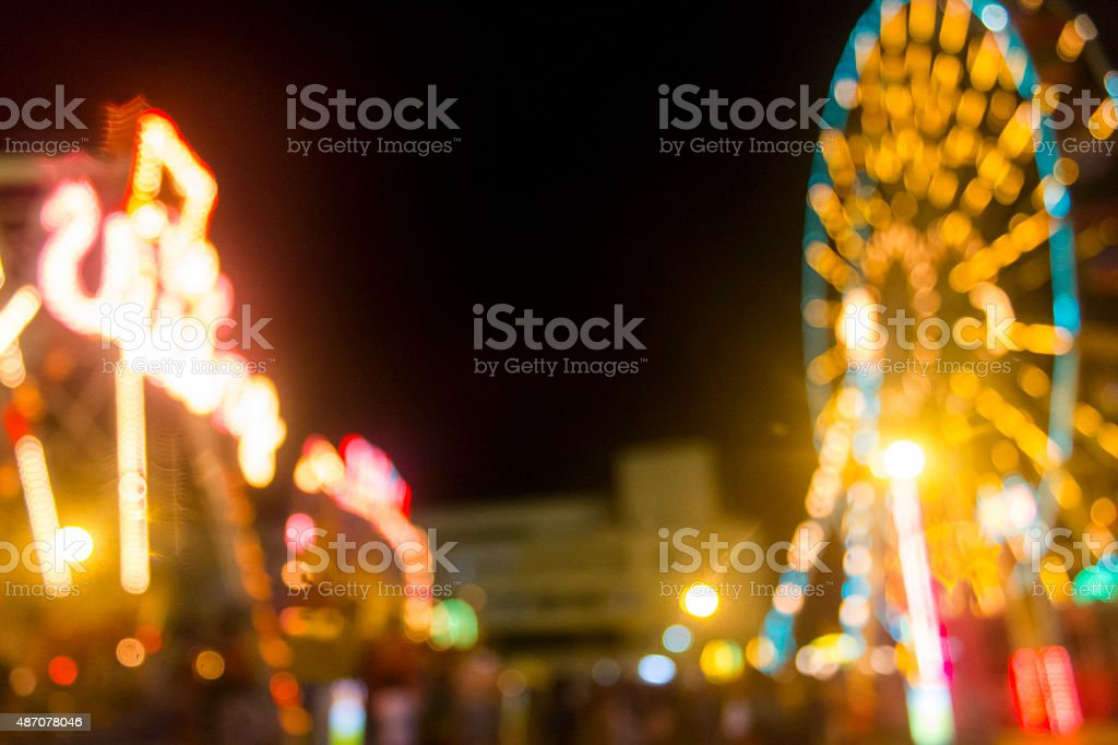 Defocused and blur image of Amusement park at night stock photo