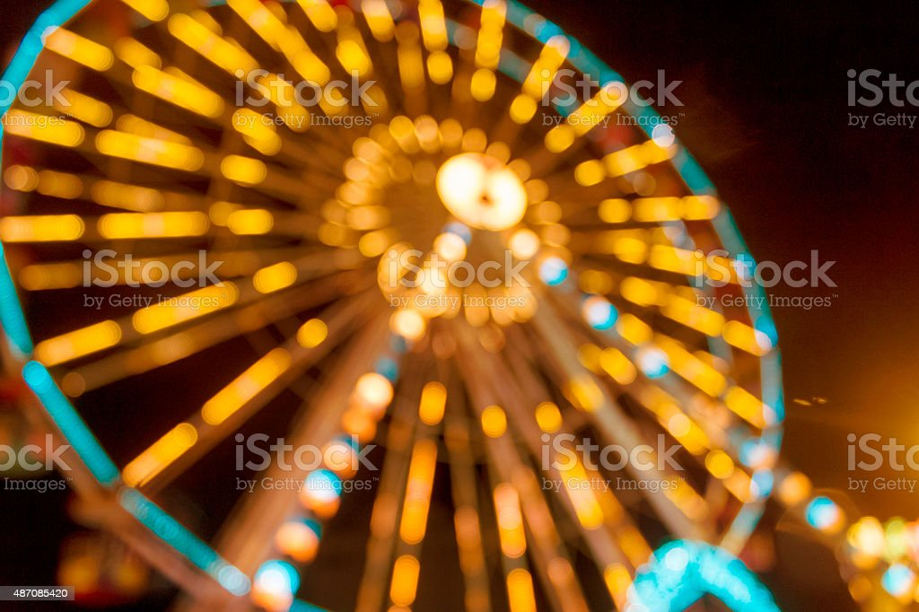 Defocused and blur image of Amusement park at night stock photo