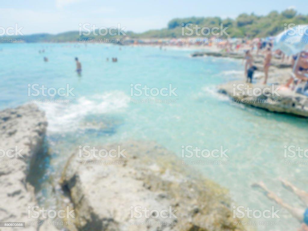 Defocused background of Baia dei Turchi beach in Salento, Italy stock photo