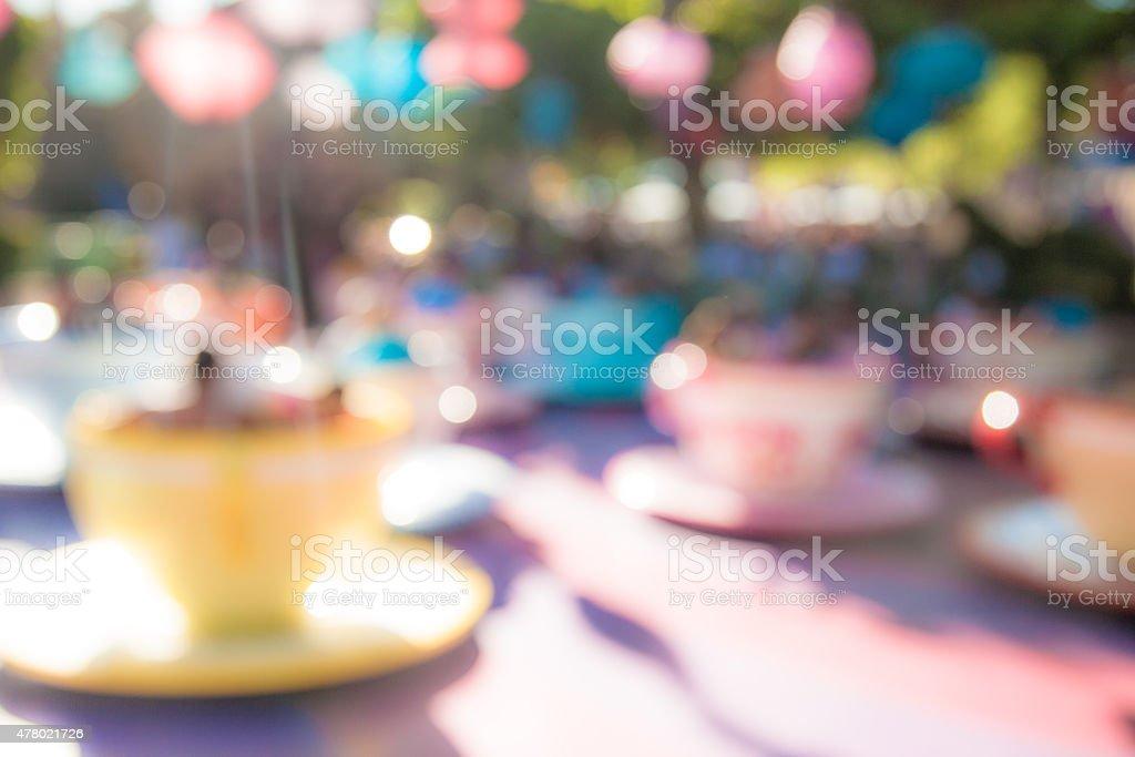 Defocused Background (Teacup Ride) stock photo