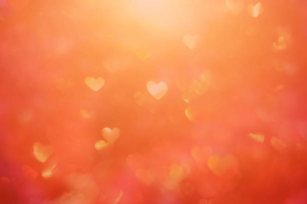 Defocused background with heart shaped bokeh stock photo