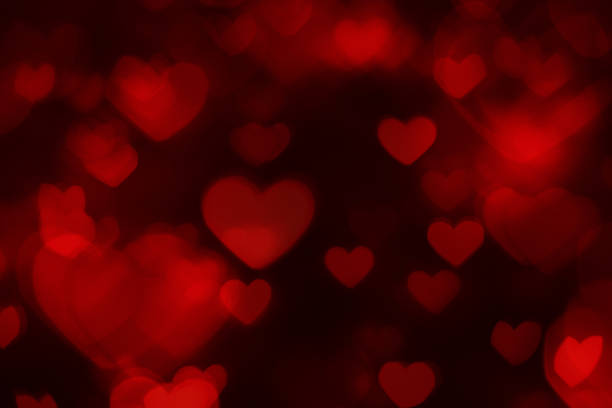 Defocused background with red heart shapes stock photo