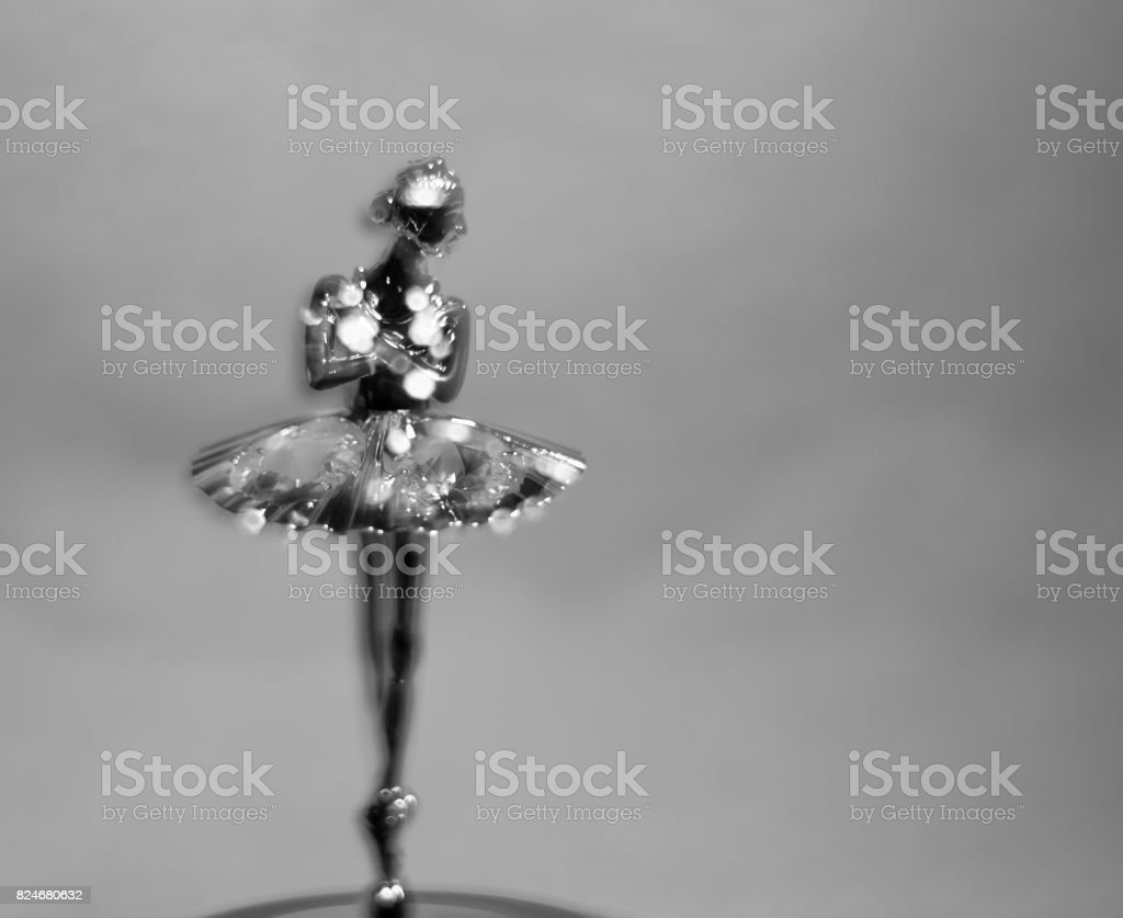 Defocused ballerina statuette. Black and white photo. stock photo