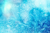 Defocused blue background with ice flowers