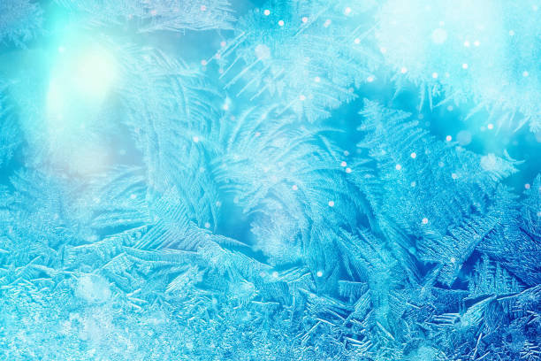defocused blue background with ice flowers - frozen stock pictures, royalty-free photos & images