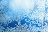 istock Defocused blue background with ice flowers 1192437435
