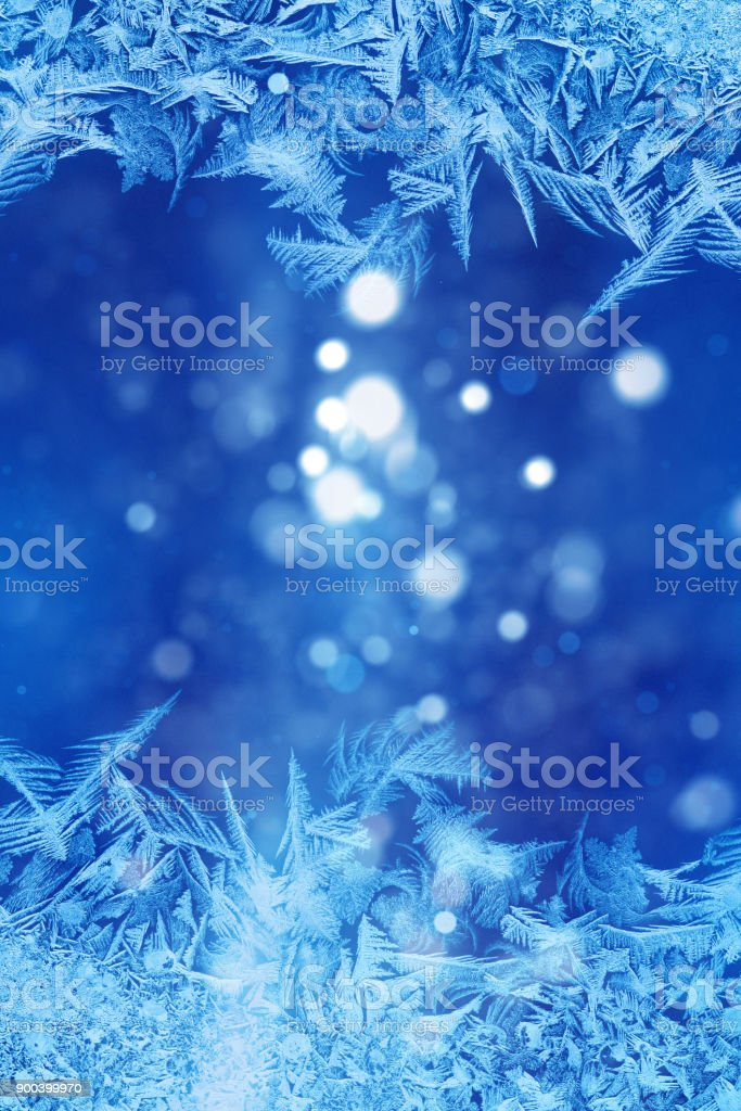 Defocused blue background with ice flowers stock photo