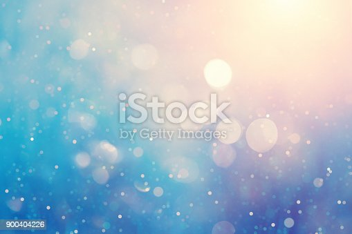 istock Defocused blue background with light spots 900404226