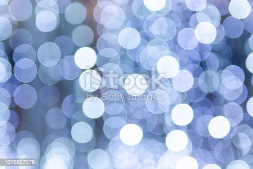 653331540istockphoto Defocused blue light background. Blue abstract bokeh background. 1076827278