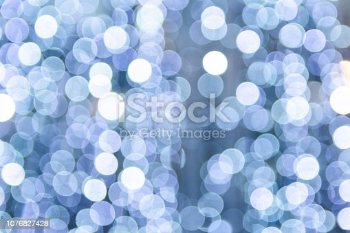 653331540istockphoto Defocused blue light background. Blue abstract bokeh background. 1076827428