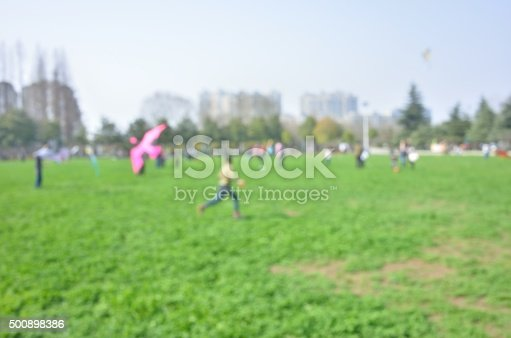 istock Defocused blur abstract background of kids playing in park 500898386