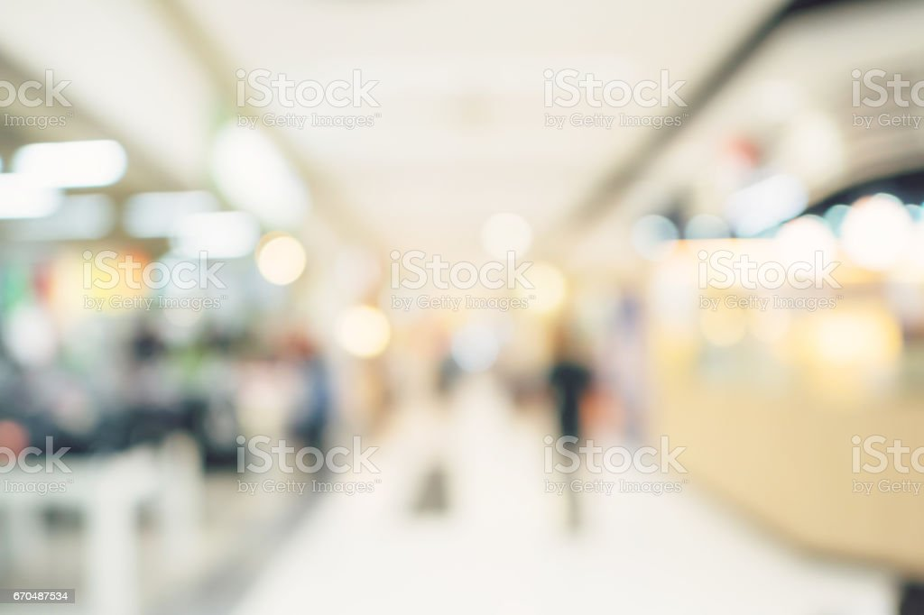Defocused blur background. People shopping in department stock photo