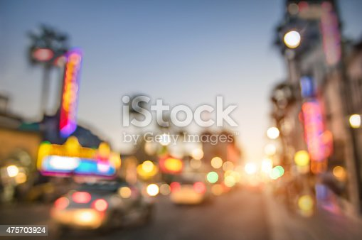 Defocused blur of Hollywood Boulevard at sunset - Bokeh abstract view of world famous Walk of Fame in California - United staes of America wonders - Emotional saturated filter with powered sunshine