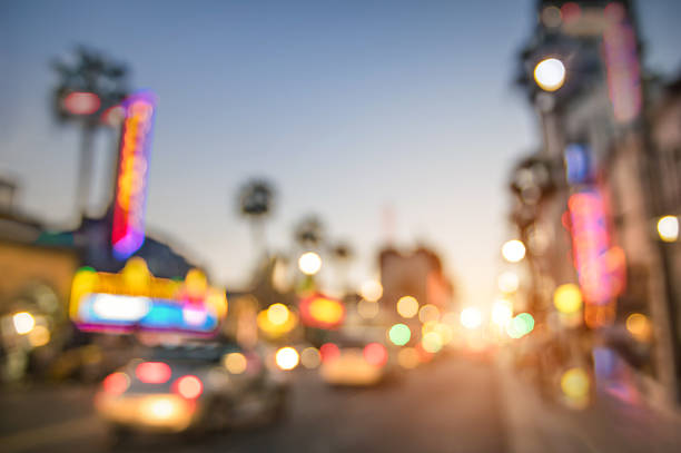 Defocused blur of Hollywood Boulevard in Losa Angeles Defocused blur of Hollywood Boulevard at sunset - Bokeh abstract view of world famous Walk of Fame in California - United staes of America wonders - Emotional saturated filter with powered sunshine hollywood boulevard stock pictures, royalty-free photos & images
