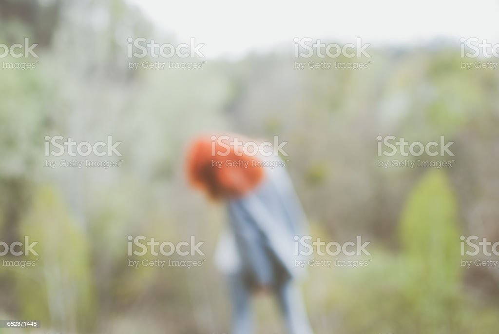 Defocused blurred background. Redhead girl wearing standing on edge royalty-free stock photo